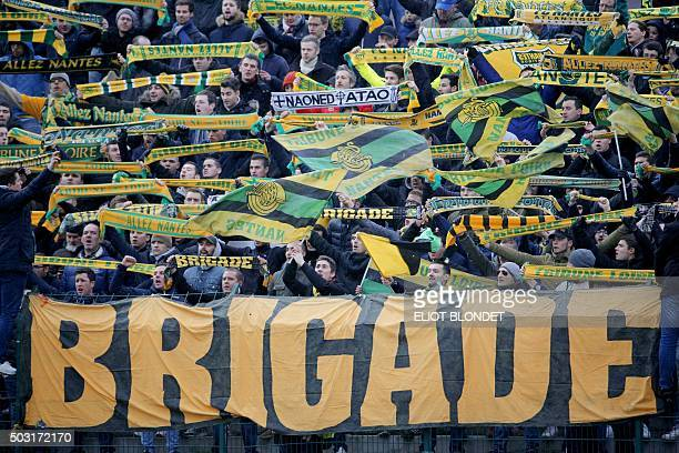 Nantes' supporters cheer during the French Cup football match opposing Le BlancMesnil to Nantes on January 2 2016 in Le BlancMesnil / AFP / Eliot...