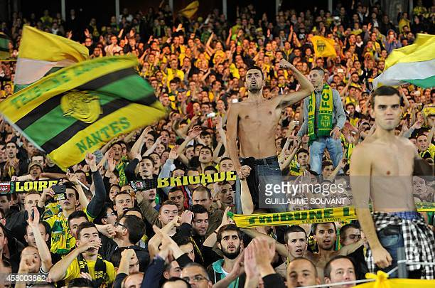 Nantes' supporters cheer during the French League Cup football match between Nantes and Laval at the La Beaujoire stadium in Nantes western France on...