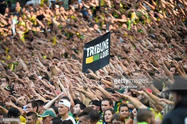 Nantes' supporters cheer for their team during the French L1 football match between Nantes and Lyon on August 26 at the Beaujoire stadium of Nantes...