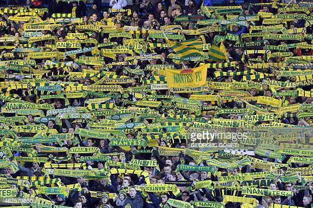 Nantes' supporters cheer their team prior the French L1 football match between FC Nantes and Lille OSC on January 31 2015 at the La Beaujoire stadium...