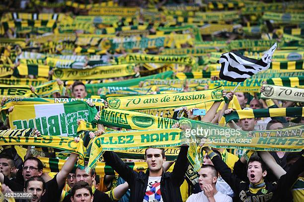 Nantes' supporters cheer their team prior to the French L1 football match Nantes vs Lens at the Beaujoire stadium on August 9 2014 in Nantes AFP...