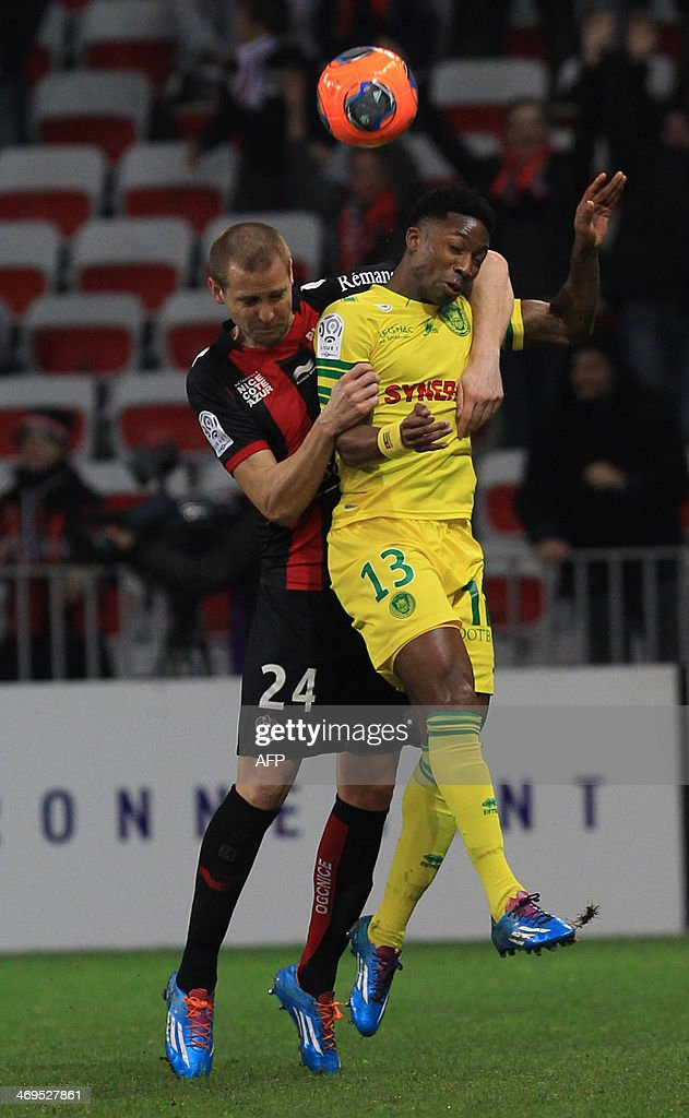 Nantes' Togolese forward Serge Gakpe (R) and Nice's French midfielder Mathieu Bodmer (L) fight for the ball during the French L1 football match between Nice (OGCN) and Nantes (FCN) on February 15, 2014 at the Allianz Riviera stadium, in Nice, southeastern France.