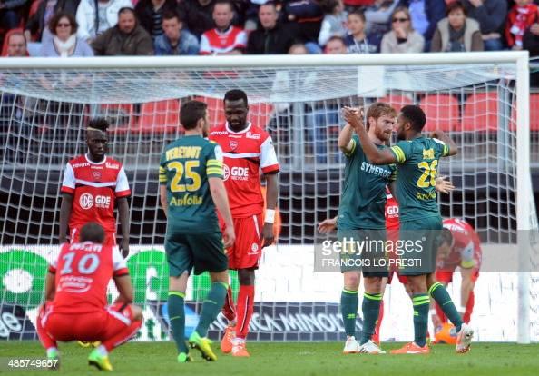 Nantes' Togolese forward Serge Gakpe is congratulated by Nantes' Venezuelan forward Fernando Aristeguieta after scoring a goal during the French L1...