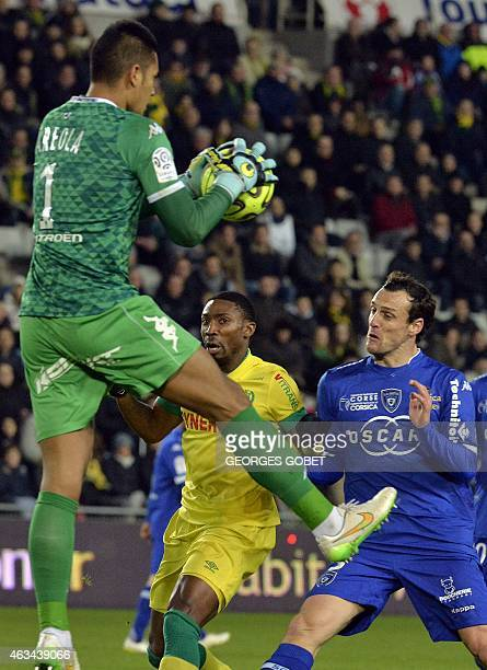 Nantes' Togolese forward Serge Gakpe vies with Bastia's French Goalkeeper Alphonse Areola Bastia's French defender Sebastien Squillaci during the...