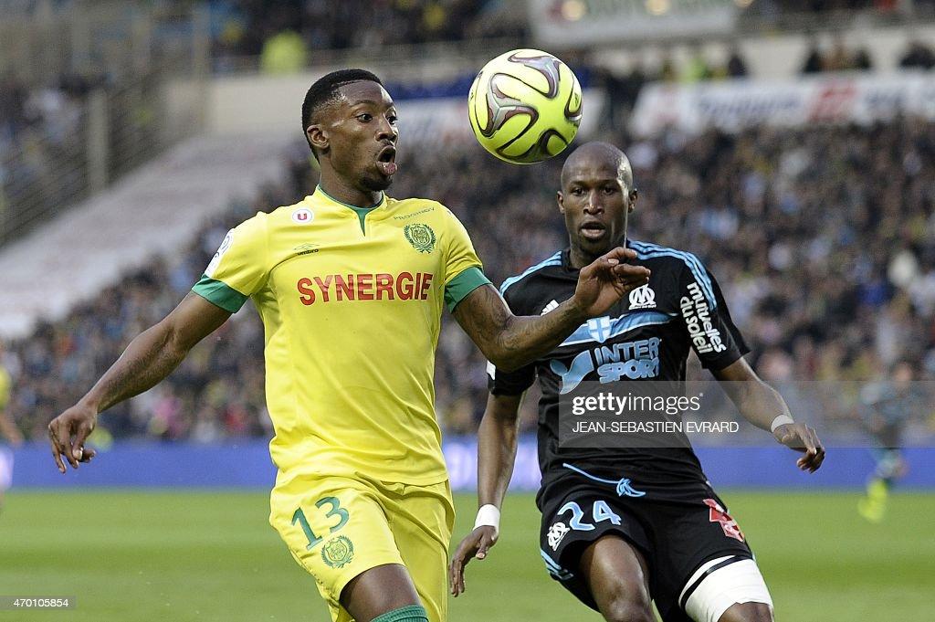 Nantes' Togolese forward Serge Gakpe vies with Marseille's French defender Rod Fanni during the French L1 football match between Nantes and Marseille...