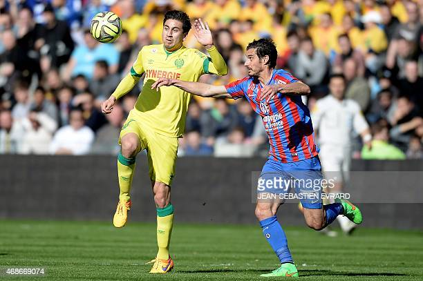 Nantes' US midfielder Alejandro Bedoya vies with Caen's French midfielder Nicolas Seube during the French L1 football match between Nantes and Caen...