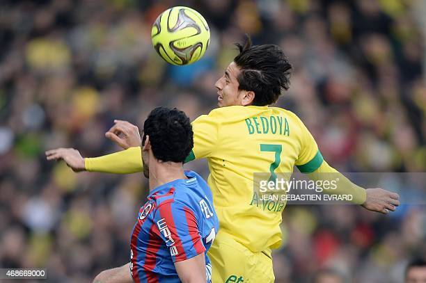 Nantes' US midfielder Alejandro Bedoya vies with Caen's Italian Brazilian defender Felipe Saad during the French L1 football match between Nantes and...