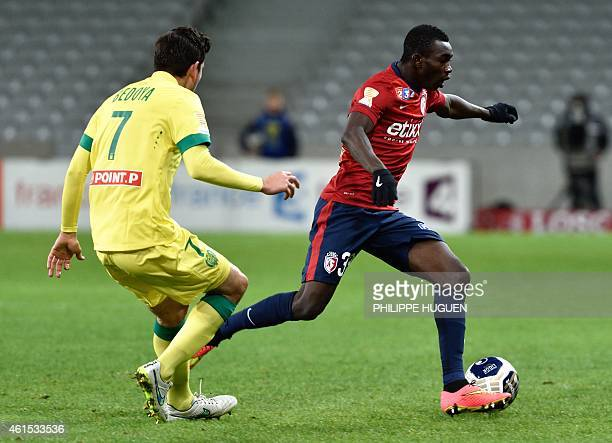 Nantes' US midfielder Alejandro Bedoya vies with Lille's Malian defender Adama Traore during the French League Cup football match Lille vs Nantes on...