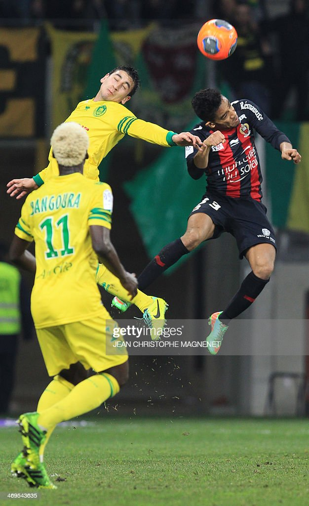 Nantes' US midfielder Alejandro Bedoya (Top L) vies with Nice's defender Jordan Amavi during the French L1 football match between OGC Nice (OGCN) and FC Nantes (FCN) on February 15, 2014, at the Allianz Riviera stadium, in Nice, southeastern France.