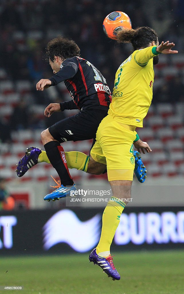 Nantes' Venezuelian defender Osvaldo Vizcarrondo (R) vies with Nice's Argentinian forward Dario Cvitanich during the French L1 football match between OGC Nice (OGCN) and FC Nantes (FCN) on February 15, 2014, at the Allianz Riviera stadium, in Nice, southeastern France. AFP PHOTO / JEAN CHRISTOPHE MAGNENET