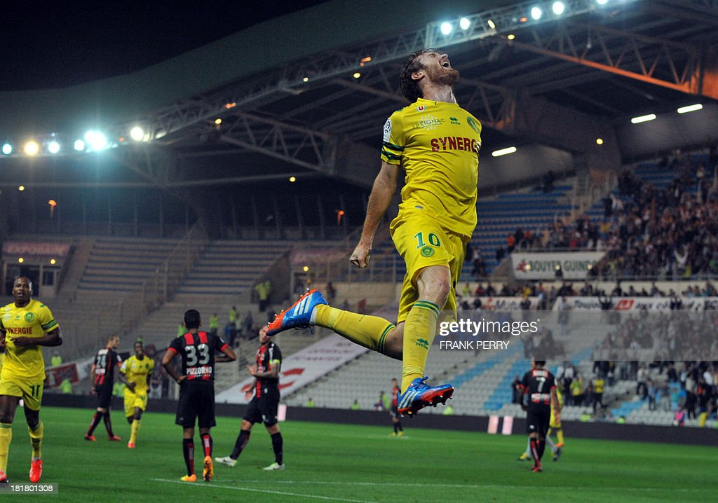 Nantes' Venezuelian-Spanish forward Fernando Aristeguieta (Up) celebrates after scoring during the French L1 football match Nantes against Nice on September 25, 2013 in La Beaujoire stadium in Nantes, western France.
