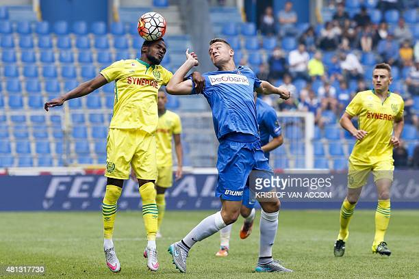Nantes' Wilfried Moimbe and Genk's Sergej MilinkovicSavic vie for the ball during a friendly football match between Genk and Nantes on July 19 2015...