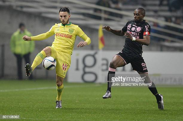 Nantes's French midfielder Adrien Thomason vies with Toulouse's FrenchIvorian midfielder JeanDaniel AkpaAkpro during the French Ligue 1 football...