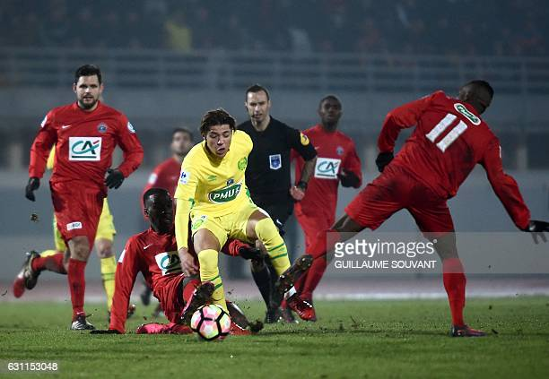 Nantes's French midfielder Amine Harit vies for the ball during the French Cup football match between Besancon vs Nancy at the Leo Lagrange stadium...