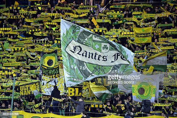 Nantes's supporters cheer for their team during the French L1 football match between FC Nantes and SC Bastia on February 14 2015 at the La Beaujoire...