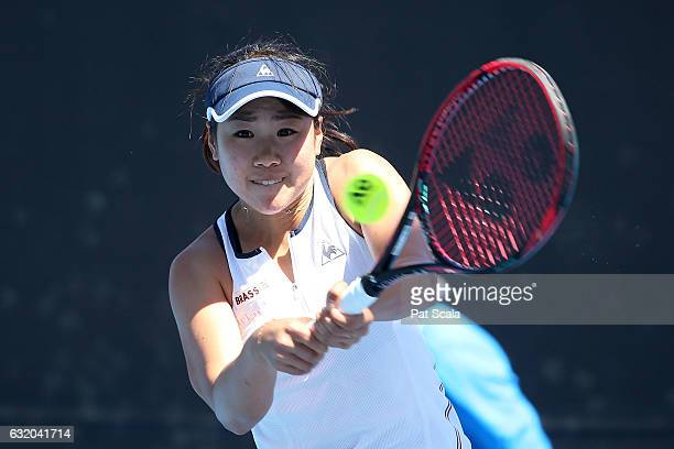 Nao Hibino of Japan and Alicja Rosolska of Poland talk tactics in their first round doubles match against Alison Riske of the United States and Yulia...