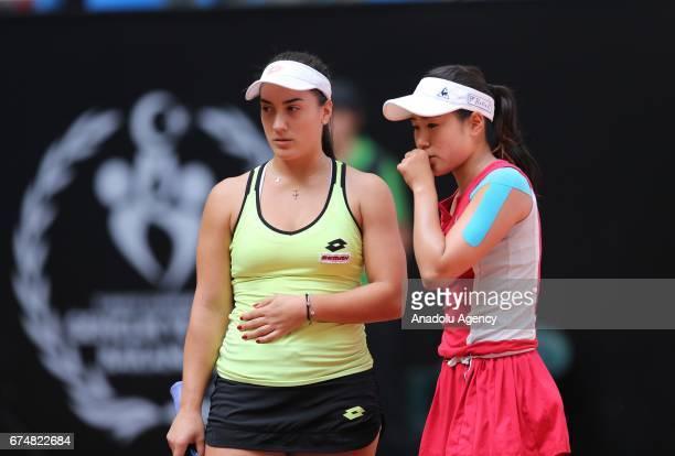 Nao Hibino of Japan and Danka Kovinic of Montenegro are in action against Dalila Jakupovic of Slovenia and Nadiia Kichenok of Ukraine during their...