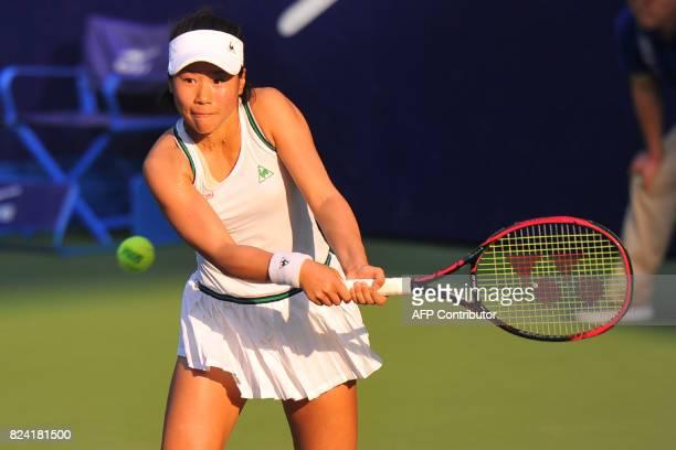 Nao Hibino of Japan hits a return against Wang Yafan of China during their women's singles semifinal match at the Jiangxi Open WTA tennis tournament...