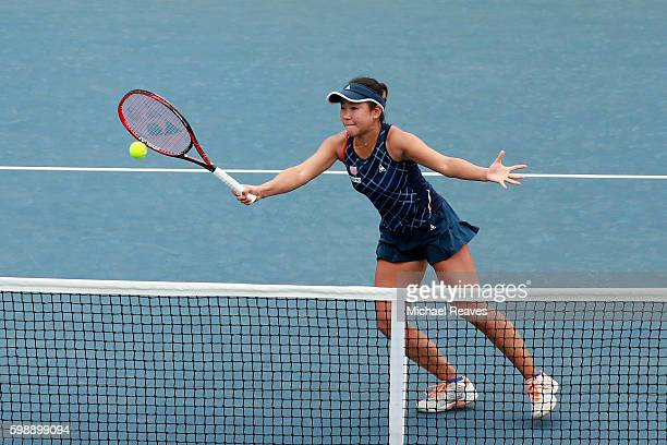 Nao Hibino of Japan in action against Michaella Krajicek of Netherlands and Heather Watson of the United Kingdom during her second round Women's...