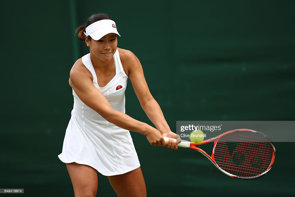 <a gi-track='captionPersonalityLinkClicked' href=/galleries/search?phrase=Nao+Hibino&family=editorial&specificpeople=7450365 ng-click='$event.stopPropagation()'>Nao Hibino</a> of Japan plays a backhand during the Ladies Singles first round match against Andrea Petkovic of Germany on day two of the Wimbledon Lawn Tennis Championships at the All England Lawn Tennis and Croquet Club on June 28, 2016 in London, England.