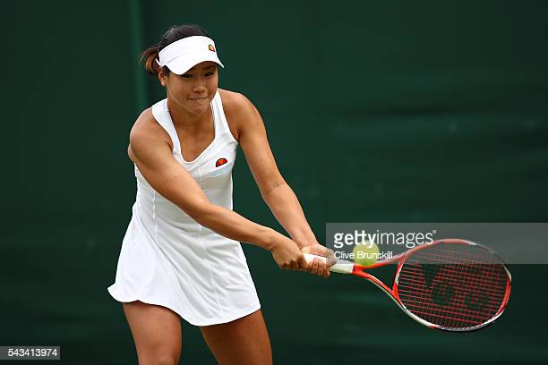 Nao Hibino of Japan plays a backhand during the Ladies Singles first round match against Andrea Petkovic of Germany on day two of the Wimbledon Lawn...
