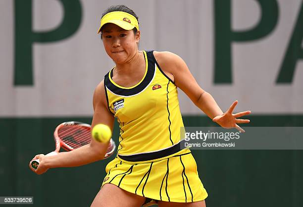 Nao Hibino of Japan plays a forehand during the Women's Singles first round match against Simona Halep of Romania on day two of the 2016 French Open...