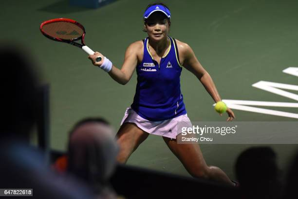 Nao Hibino of Japan plays a shot to Magda Linette of Poland during the Semi Finals of the 2017 WTA Malaysian Open at the TPC on March 4 2017 in Kuala...