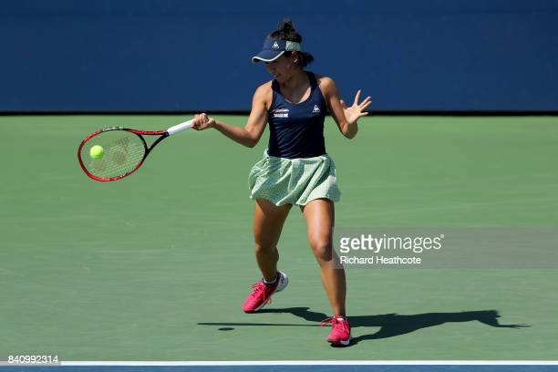 Nao Hibino of Japan returns a shot to Catherine Bellis of the United States during their first round Women's Singles match on Day Three of the 2017...