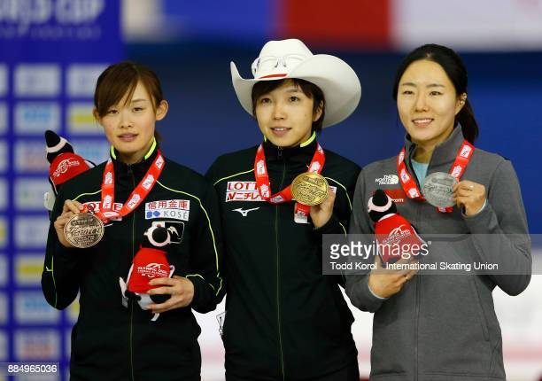 Nao Kodaira of Japan celebrates her gold medal with SangHwa Lee of Korea who won silver and teammate Arisa Go who won bronze in the women's 500 meter...