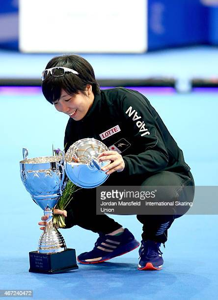 Nao Kodaira of Japan picks up the lid of the cup after she drops it after winning the Women's 500m World Cup on Day 2 of the ISU World Cup Speed...