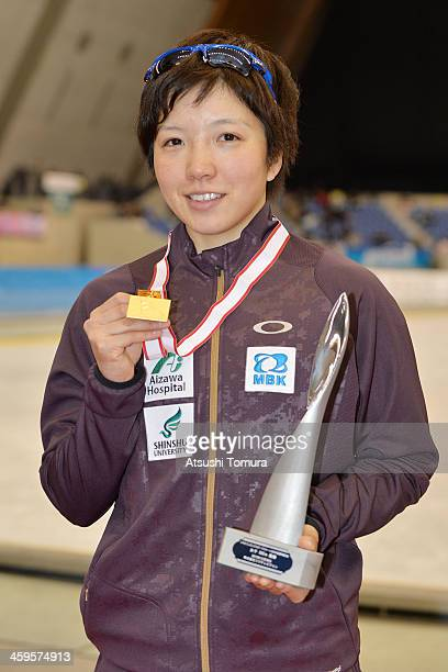 Nao Kodaira of Japan poses with the gold medal after winning the women's 500m victory ceremony during the Japan Speed Skating Olympic Qualifying...