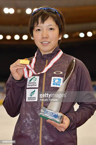 Nao Kodaira of Japan poses with the gold medal in the women's 1000m victory ceremony during Japan Speed Skating Olympic Qualifying Championships at M...