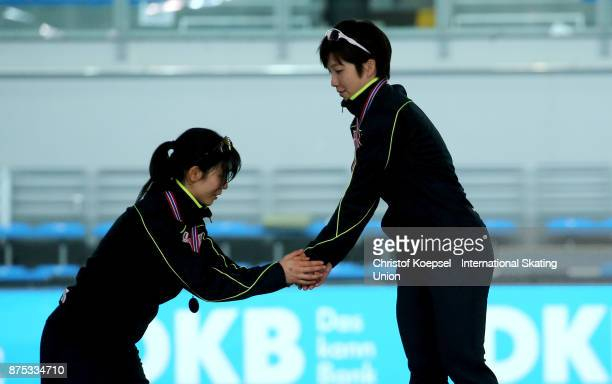 Nao Kodaira of Japan shake hands with second placed #Miho Takagi of Japan during the medal ceremony of the ladies 1000m Division A race of Day 1 of...
