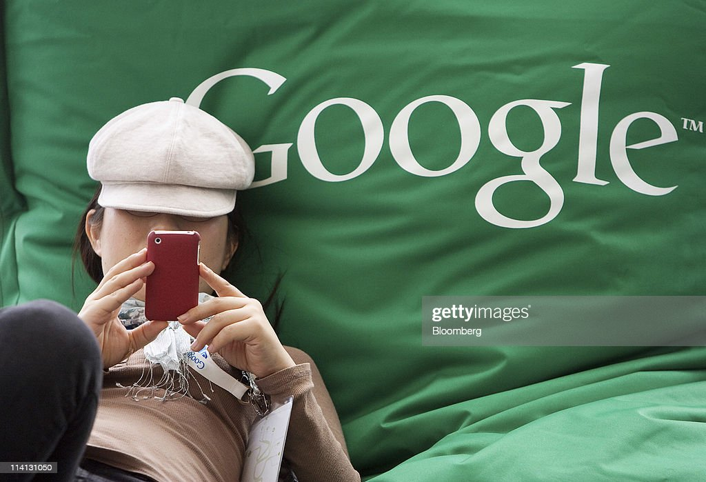Nao Tanaka of Kyocera takes a break to send a text with a mobile device at the Google I/O conference in San Francisco, California, U.S., on Wednesday, May 11, 2011. Google Inc., the world's largest Internet-search company, is making a bigger push into entertainment services, adding music storage and movie-rental features to its Android software for phones and tablets. Photographer: David Paul Morris/Bloomberg via Getty Images