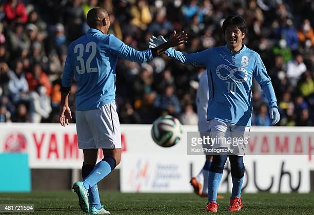 Naohiro Takahara of J Amigos celebrates scoring his team's second goal with his team mate Hiroshi Nanami during the Daisuke Oku Memorial Match...