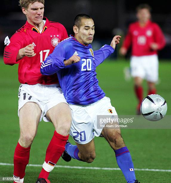 Naohiro Takahara of Japan and Per Mertesacker of Germany compete for the ball during the international friendly match between Japan and Germany at...
