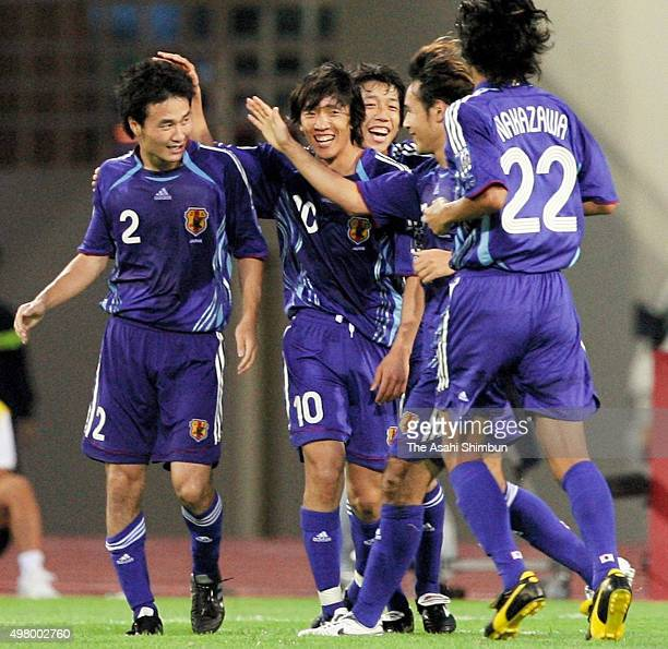 Naohiro Takahara of Japan celebrates scoring his team's first goal with his team mates during the AFC Asian Cup Group B match between Japan and Qatar...