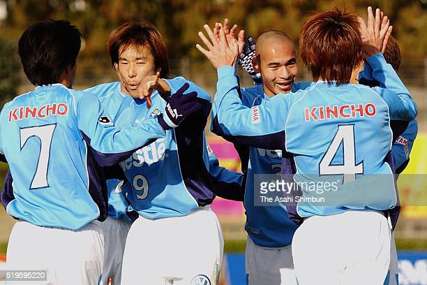 Naohiro Takahara of Jubilo Iwata celebrates scoring his team's second goal with his team mates during the JLeague match between Kyoto Purple Sanga...