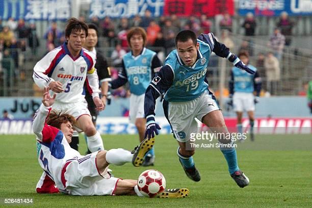 Naohiro Takahara of Jubilo Iwata goes past Tetsuya Ito of FC Tokyo during the JLeague match between Jubilo Iwata and FC Tokyo at the Jubilo Iwata...