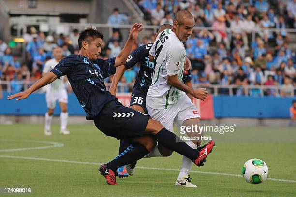 Naohiro Takahara of Tokyo Verdy and Bae Seung Jin of Yokohama FC compete for the ball during the JLeague second division match between Yokohama FC...