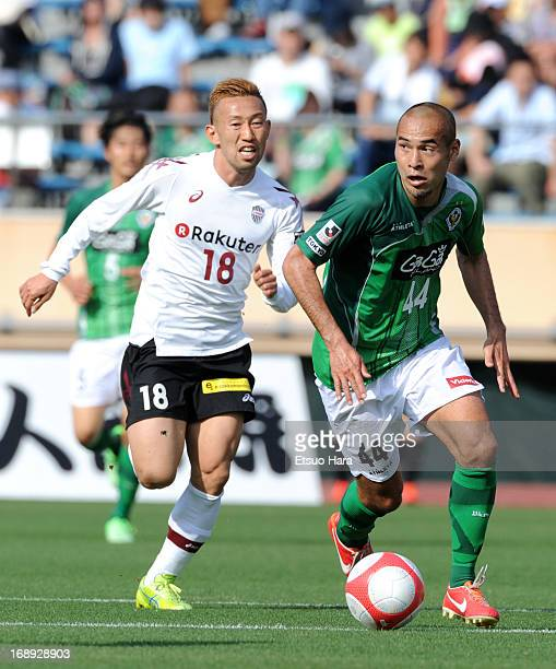Naohiro Takahara of Tokyo Verdy and Hideo Tanaka of Vissel Kobe compete for the ball during the JLeague second division match between Tokyo Verdy and...