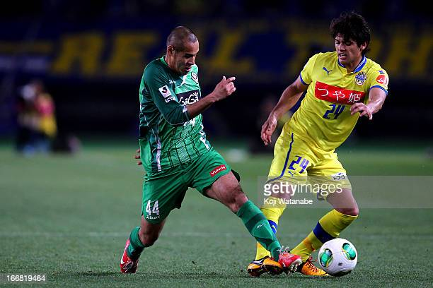 Naohiro Takahara of Tokyo Verdy and Romero Frank of Montedio Yamagata compete for the ball during the JLeague second division match between Tokyo...