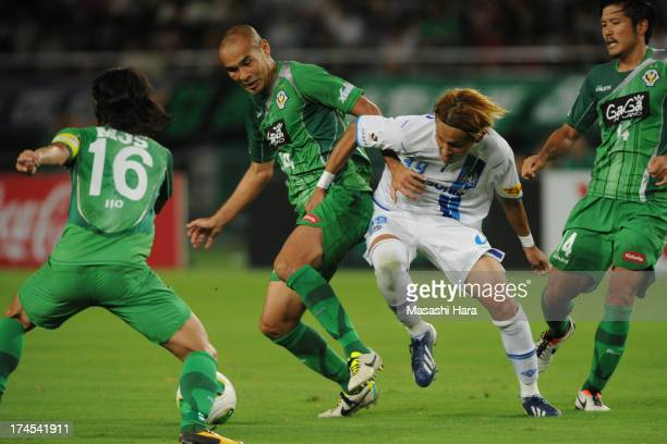 Naohiro Takahara of Tokyo Verdy and Takashi Usami of Gamba Osaka compete for the ball during the JLeague second division match between Tokyo Verdy...