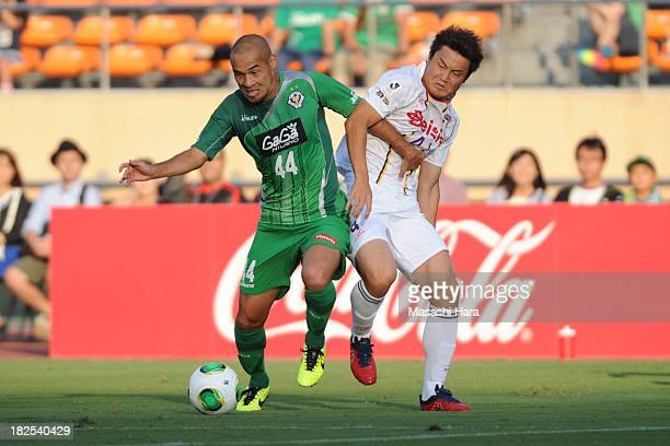 Naohiro Takahara of Tokyo Verdy and Tatsushi Koyanagi of Thespa Kusatsu Gunma compete for the ball during the JLeague second division match between...