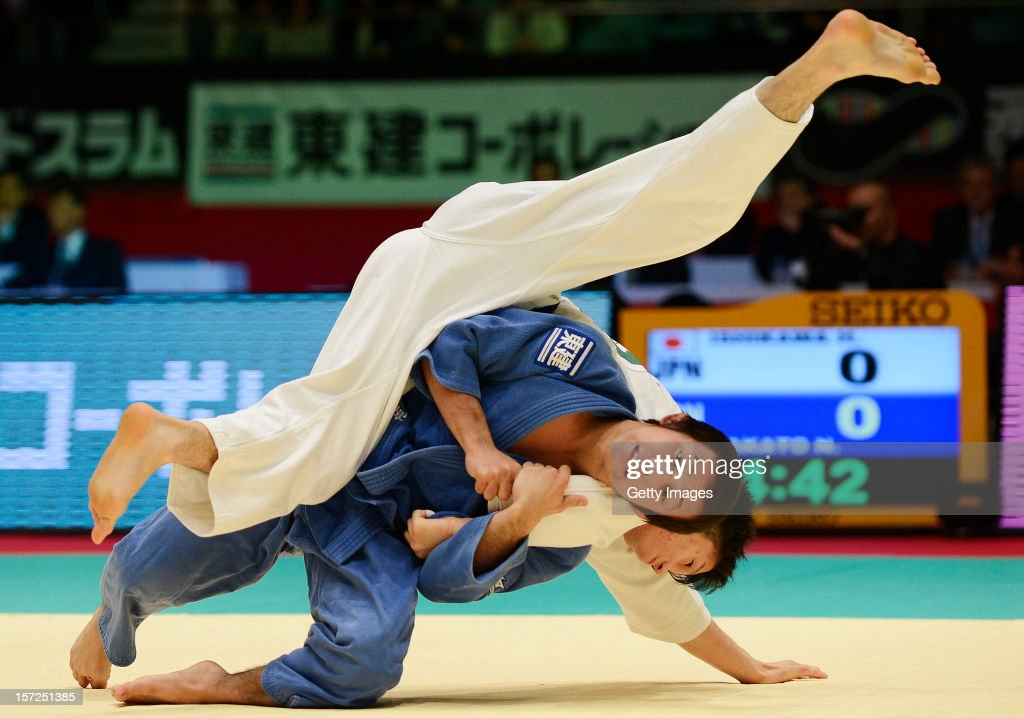 Naohisa Takato (L) throws Hironori Ishikawa of Japan in the Men's 60kg final during day one of the Judo Grand Slamat Yoyogi Gymnasium on November 30, 2012 in Tokyo, Japan.