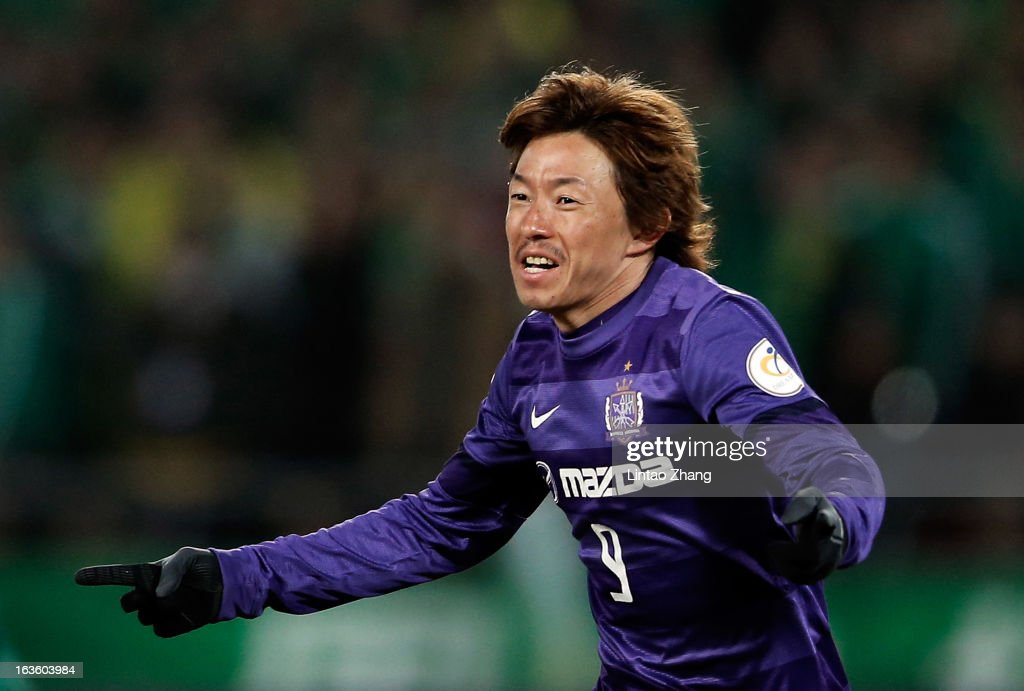 <a gi-track='captionPersonalityLinkClicked' href=/galleries/search?phrase=Naoki+Ishihara&family=editorial&specificpeople=6849862 ng-click='$event.stopPropagation()'>Naoki Ishihara</a> of Hiroshima Sanfrecce celebrates scoring his first goal during the AFC Champions League Group match between Hiroshima Sanfrecce and Beijing Guoan at Beijing Workers' Stadium on March 13, 2013 in Beijing, China.