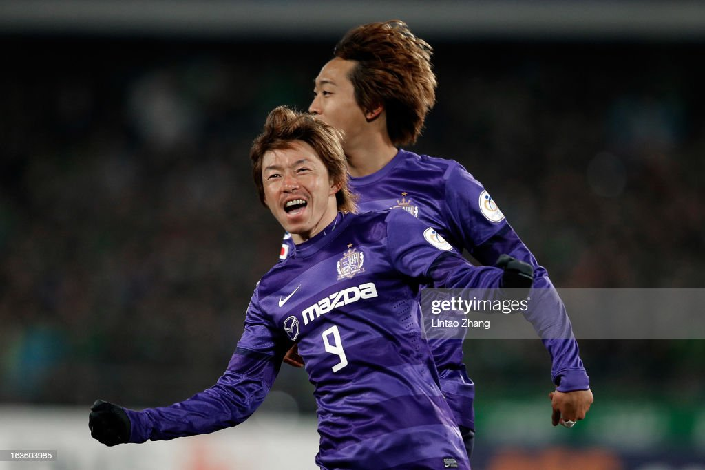 Naoki Ishihara (#9) of Hiroshima Sanfrecce celebrates scoring his first goal during the AFC Champions League Group match between Hiroshima Sanfrecce and Beijing Guoan at Beijing Workers' Stadium on March 13, 2013 in Beijing, China.