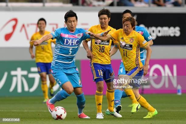 Naoki Ishihara of Vegalta Sendai and Kim Min Hyeok of Sagan Tosu compete for the ball during the JLeague J1 match between Sagan Tosu and Vegalta...