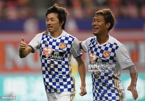 Naoki Ishihara of Vegalta Sendai celebrates scoring his side's first goal with his team mate Gakuto Notsuda during the JLeague J1 match between...