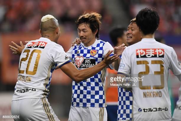 Naoki Ishihara of Vegalta Sendai celebrates scoring his side's first goal with his team mates during the JLeague J1 match between Albirex Niigata and...
